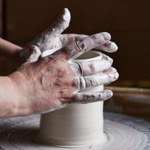 Elaine Bolt throwing on the potter's wheel (photography by Alun Callender)