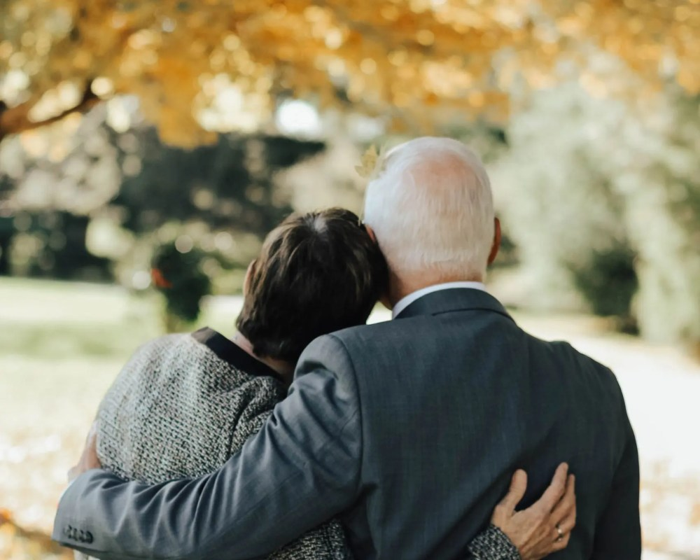 older couple arms around each other