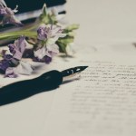 Pen, paper and flowers