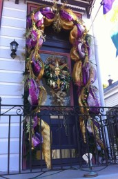 New Orleans door decorated for Mardi Gras