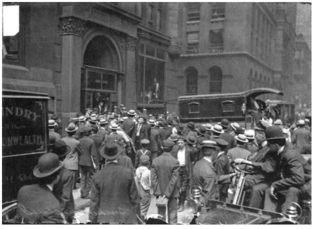 Crowd outside a bucket shop. People wore a lot of hats back then.