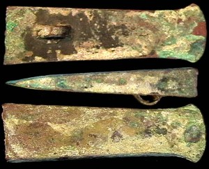 Zhou dynasty hand axe 釿. Actual weight of an axe blade: 200g. Weight of 釿 coins: 12g.  The ring is for tying the blade to the handle.