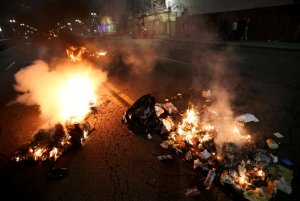 Multiple fires are lit in dumpsters and trash cans during protests in Oakland, Calif., late Tuesday, Nov. 8, 2016. President-elect Donald Trumpís victory set off multiple protests. (Jane Tyska/Bay Area News Group via AP)