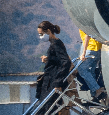 Angelina Jolie dons a facemask as she arrives with her kids on a private jet in Burbank after a short trip 3