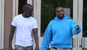 Kanye West loads up on children's clothes from Walmart and visits the bank with friend Damon Dash who denies the rapper is 'crazy'
