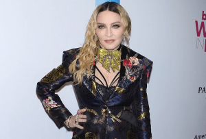 Madonna, 61, goes TOPLESS while leaning on a crutch as she bares all in VERY racy mirror selfie nearly four months after knee injury
