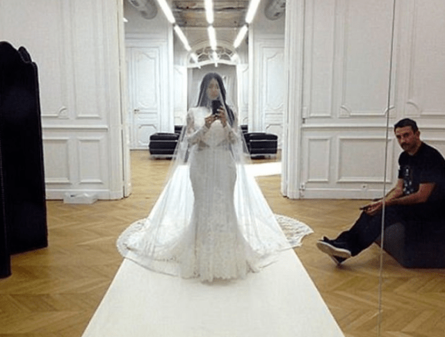 Kim Kardashian shares throwbacks of herself trying on her wedding dress after denying reports she is 'torn' about leaving Kanye West 9