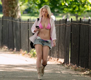 Lottie Moss in a bright pink bikini and ripped shorts while out in London on Sunday