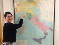 Genoese speaker Sara Galli points to her village on a map of Italy
