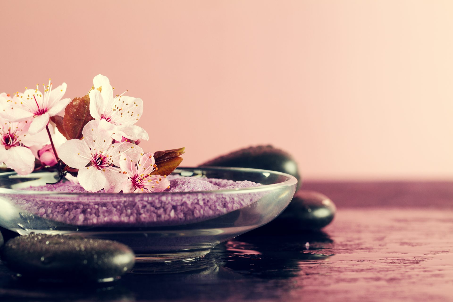 Spa Concept. Closeup of beautiful Spa Products – Spa Salt and Fl
