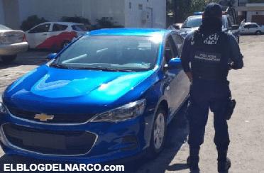 Comando armado roba 7 vehículos de agencia en Michoacán