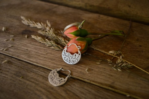 Bramble earrings and ring on oak
