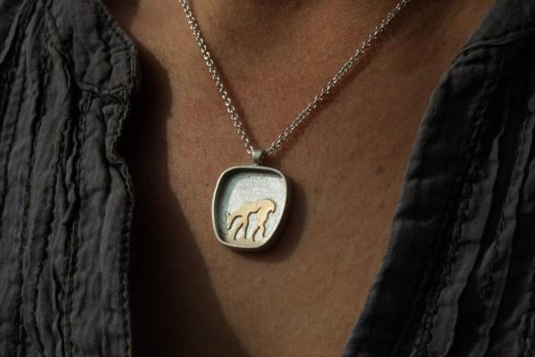 God deer pendant up close