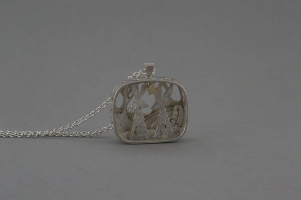 Two haref front of pendant