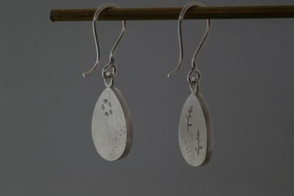 Earrings hanging up backs