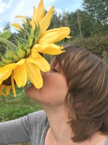 Me smelling a sunflower
