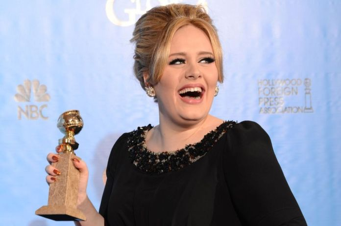 Adele poses in the press room at the awards ceremony of the Golden Globes in Beverly Hills on January 13, 2013 (Photo: AFP)