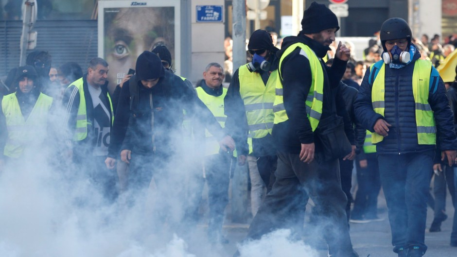 Protesters throw back tear gas canisters during yellow vests demonstration in Marseille on January 26, 2019.