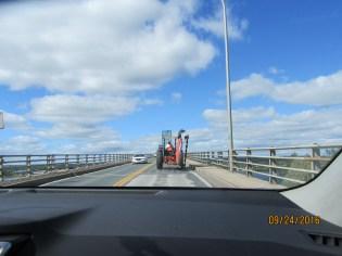 tractor driving over the bridge- small town New brunswick