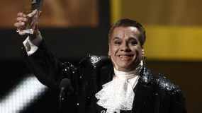 FILE - In this Nov. 5, 2009, file photo, Mexican singer Juan Gabriel accepts the person of the year award at the 10th Annual Latin Grammy Awards in Las Vegas. Representatives of Juan Gabriel have reported Sunday, Aug. 28, 2016, that he has died. Gabriel was Mexico's leading singer-songwriter and top-selling artist with sales of more than 100 million albums. The statement says he died Sunday, but did not say where. (AP Photo/Matt Sayles, File)