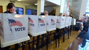 People vote on the US presidential election at Santa Monica City Hall on November 8, 2016 in Santa Monica, California. America's future hung in the balance Tuesday as millions of eager voters cast ballots to elect Democrat Hillary Clinton as their first woman president, or hand power to the billionaire populist Donald Trump. / AFP / Frederic J. BROWN