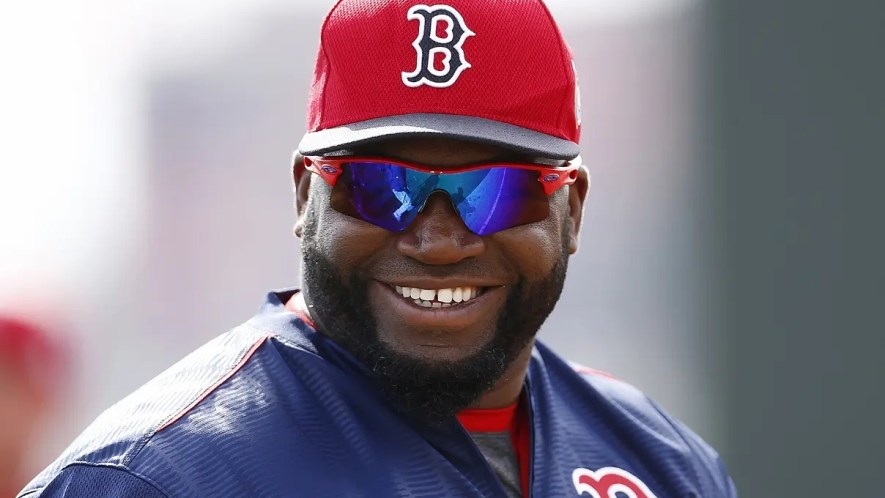 Boston Red Sox designated hitter David Ortiz smiles during a spring training baseball workout in Fort Myers, Fla. Wednesday, Feb. 24, 2016.  (Corey Perrine/Naples Daily News via AP)  FORT MYERS OUT; MANDATORY CREDIT
