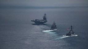 El portaaviones USS Carl Vinson (izquierda) y los otros buques se encontraban en el Océano Índico durante el fin de semana, y no en el Mar de Japón, tal como dijo Estados Unidos.