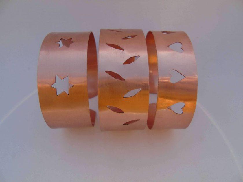 three pierced copper cuff bracelets