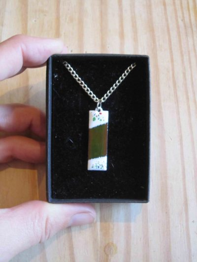 green enamelled rectangular necklace with white ends