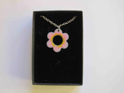pink enamelled daisy shape necklace with yellow around centre hole