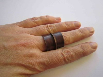 large fold formed cuff ring with patina being worn