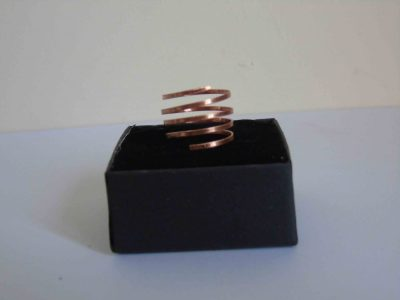 side view of copper ring with lots of narrow spirals