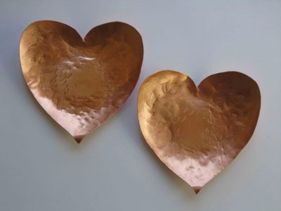 Two heart shaped bowls to show ach is different