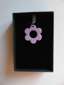pink enamelled daisy shaped necklace