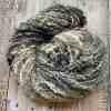 monochromatic art yarn on wood background