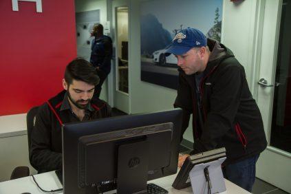 Cleveland Tesla representative checks in a Model 3 reserver from Buffalo, NY.