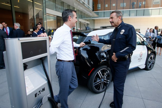 Los Angeles City Mayor Eric Garcetti and Los Angeles Police Department Chief Charlie Beck announce a year long test of a BMW i3 electric vehicle at a City of Los Angeles press conference in Los Angeles, Sept. 11, 2015. Photo by Danny Moloshok/Newscast