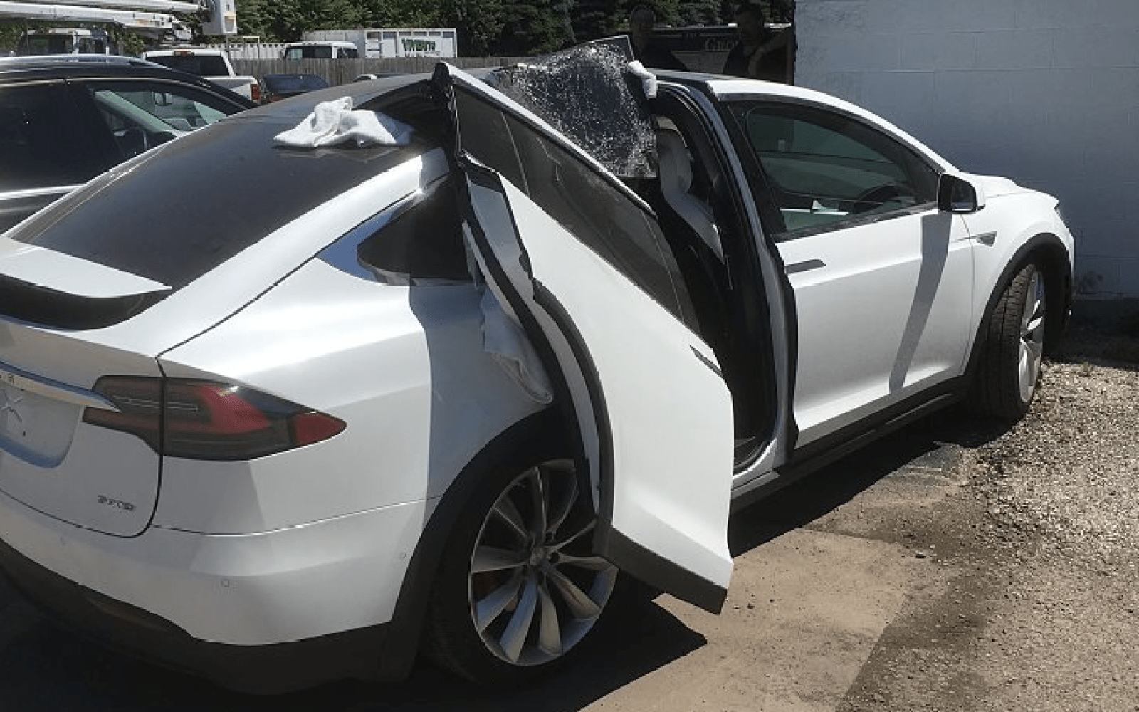 Tesla Model X Clipped One Of Its Falcon Wings On A Garage