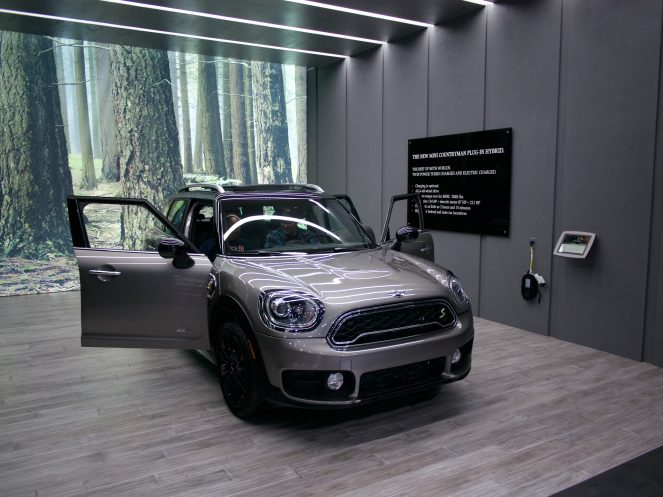 """MINI Countryman Plug-in Hybrid display - """"Charging is optional"""" says the wall, isn't the point of getting an EV to make GAS optional? Come on BMW, get with the program."""