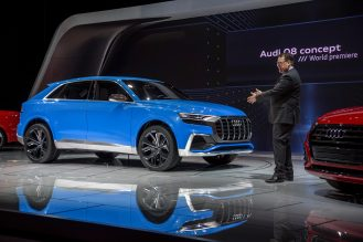 Dr. Dietmar Voggenreiter (Member of the Board of Management of AUDI AG for Sales and Marketing) in front of the Audi Q8 concept at the 2017 North American International Auto Show.
