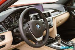 300 interior dashboard navigation system BMW 330e Hybrid 3 series sports sedan review