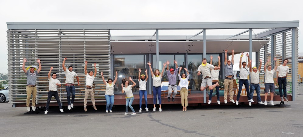 Stevens Institute of Technology team members celebrate their overall 1st place victory at their house at the U.S. Department of Energy Solar Decathlon 2015, October 17, 2015 at the Orange County Great Park, Irvine, California (Credit: Thomas Kelsey/U.S. Department of Energy Solar Decathlon)