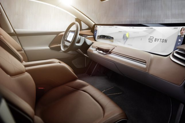 BYTON's Shared Experience Display includes sensors that enable front and rear passengers to control the screen using hand gestures. (PRNewsfoto/BYTON)