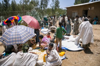 At a Concern supplementary food distribution in North Gonder, Ethiopia. The monthly distributions are targetting under-5 children and preganant and breastfeeding mothers who have been identified as malnourished. They are each given 6.25 kgs of corn/soy blend and one litre of oil.