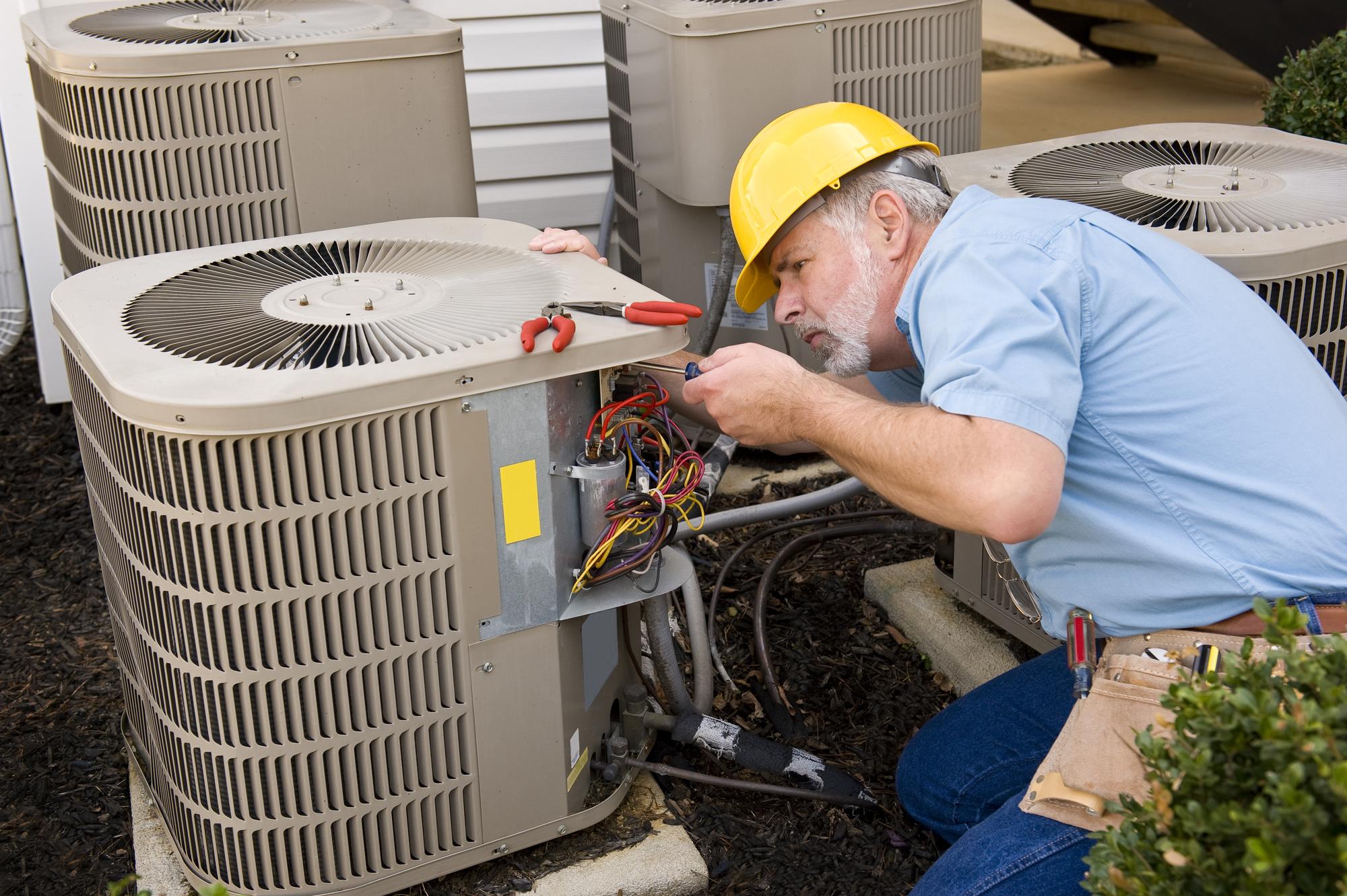 An HVAC Technician at work