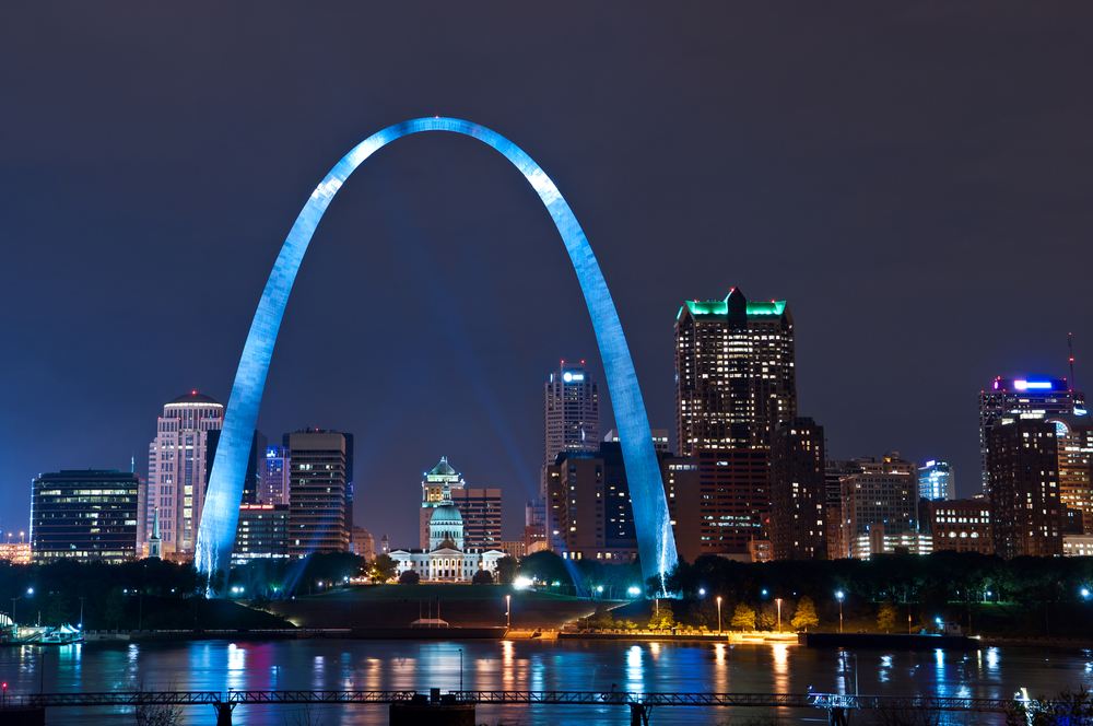 Image of St. Louis downtown with Gateway Arch at night.