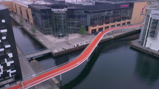 "The new cycle path bridge across the Copenhagen harbour, called ""Cykelslangen"" (translated: the Cycle Snake)"
