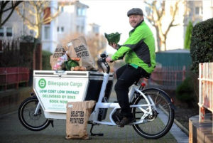 23/12/2015 - Pic by Lucy Davies Business development manager at Bikespace Brett Nicolle who is delivering vegetables for Plymouth residents on an electric bike. Reporter Sarah Contact Brett on 396737