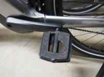 That's sandpaper on the pedals! It works surprisingly well