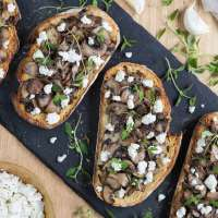 Garlicky mushroom crostini with goat cheese crumbles